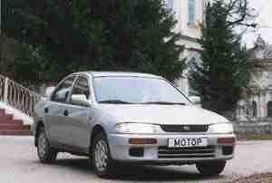 Серебристый седан (Mazda 323, 1997 год)
